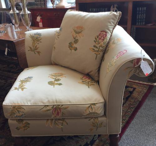 "GOLD CORNER CHAIR IN FLORAL PRINT 34""SQ X 3'H $295"