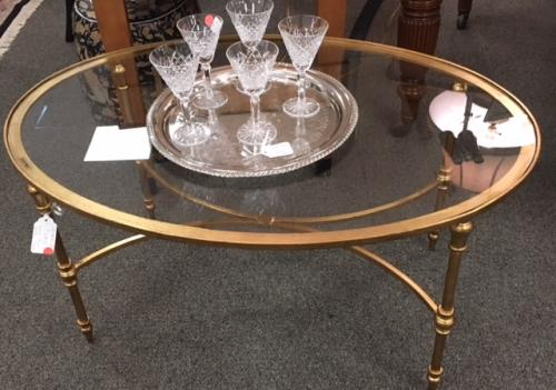 "OUR #1 SELLING OVAL BRASS COFFEE TABLE 40""W X 28""D X 20""H $595"