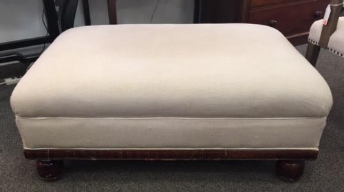 "BEIGE UPHOLSTERED OTTOMAN W/ WOOD FRAME 42""W X 30""D X 17""H CONSIGNED AT $395 REDUCED TO SELL $315"