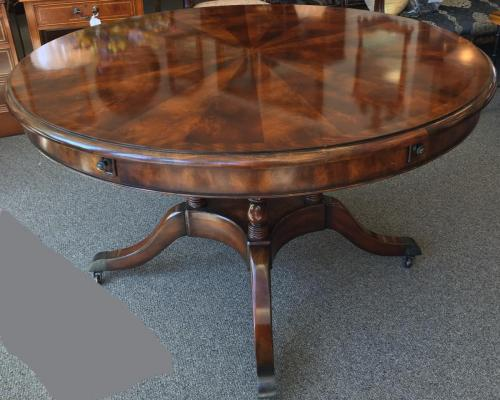 "MAHOGANY DINING TABLE W/ BIRDCAGE BASE 48""ROUND X 30""H ADD-ON EXTERIOR LEAVES 12""W $995"