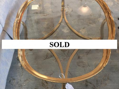 "OVAL BRASS COFFEE TABLE WITH GLASS TOP 30""W X 45""L $495"