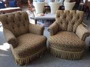 PAIR OF TUFTED UPHOLSTERED CHAIRS WITH FRINGE ACCENT $350