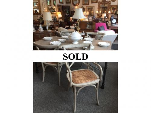 4 FRENCH HERITAGE WEATHERED CHAIRS W/ CANE SEATS $495  WEATHERED TABLE ON CASTORS 3' X 5.5' $795